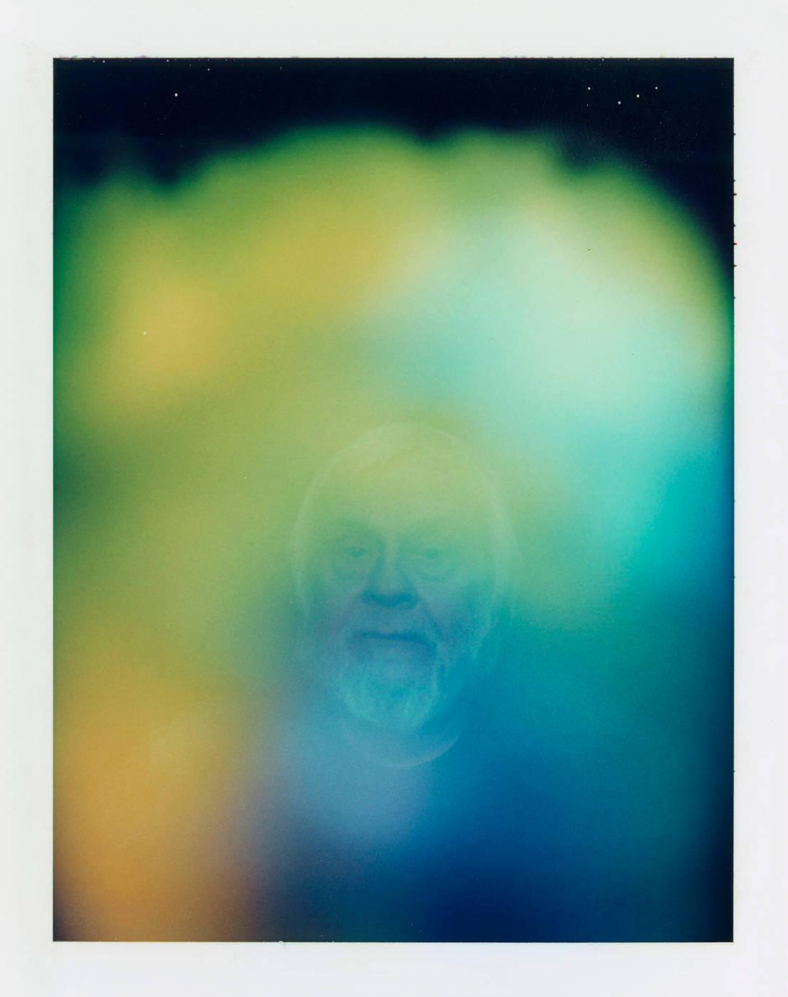 Portrait of man enveloped in hazy gradient color