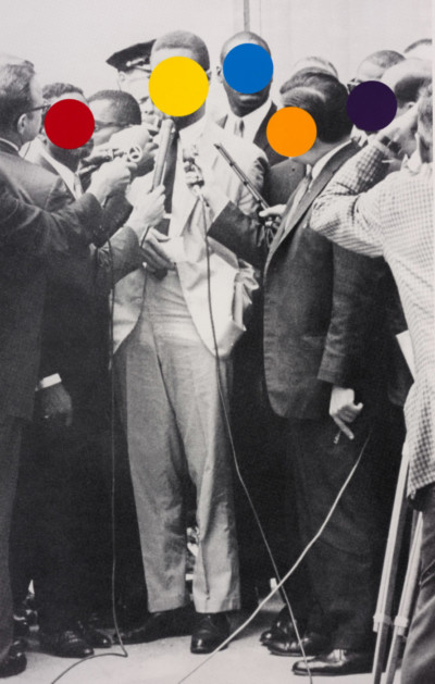 A group of people in historical photograph, their faces covered with four colorful dots